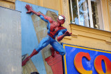 Spiderman hanging onto the wall at a comic shop in the Vienna Altstadt