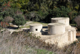 A home consisted of several round buildings make of stone with flat roofs arranged around a small courtyard