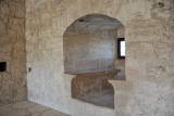 Niche with stone benches and a small window built into the thick walls of Kolossi Castle