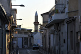 Ankara Street, just to the north of the medieval castle of Limassol, with the minaret of the Cami Cedid