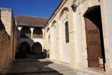The monastery surrounds the church on three sides