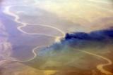 Senegal-Mauritania border - fire burning along the Senegal River near Tiguet