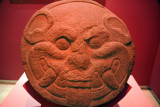 Stone disk found at Cara Sucia with the shape of a jaguar head, associated with the sun, from the Cotzumalhuapa culture