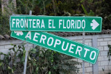 Roadsigns for the Guatemalan border and Copan Airport
