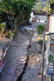 Major erosion to a street on the steep hillside of the upper town, Copan Ruinas