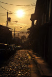 Sunset over a cobble stone street of Copan Ruinas