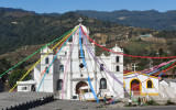 A church with festive banners along the Panamericana approaching Los Encuentros