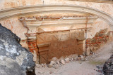 A bricked up doorway, now mostly buried, La Recolección