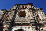 Intricately decorated southern façade with its large octagonal window, Antigua Guatemala