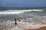Not idea for swimming, some boys wade into the sea - Galle Face