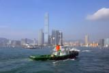 Tugboat in front of the growing skyline of Kowloon