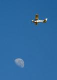 Cessna with the moon, Botswana