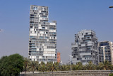 Modern buildings along the Mediterranean coast behind Llevent Beach