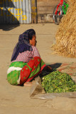 Nepali woman with some kind of vegetables