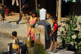 Nepali children around the public water tap, Mahadevabesi