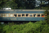 Bangladesh Railway interCity train underway on the edge of Dhaka