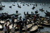 Hundreds of sampans and other little wooden boats plying the Buriganga River in the center of Dhaka