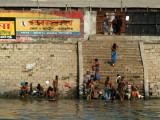 Bangladeshi men bathing along the ghat (the steps leading down to the river) Dhaka