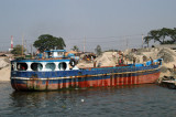 One of the Bangladeshi sand freighters unloading its cargo next to the Fatulla ferry pier