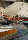 Naked boys playing on a loaded sand freighter, Fatulla