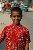 Boy in a red shirt along the road to Dhaka in Fatulla