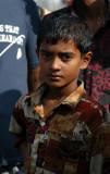 Boy in a nice shirt at the cattle market, Fatulla