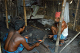 A pair of blacksmiths working a piece of red hot iron, Fatulla