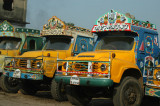 Painted Bangladeshi Bedford trucks parked on the side of the road to Dhaka