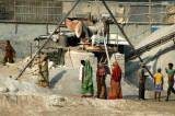 Female laborers at a gravel crusher along the road to Dhaka