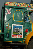 Side windows of a truck cab painted over...brilliant idea