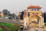 Gate to Lang Phu Coc, about 30 minutes south of Hanoi on Route 1A