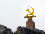 Communist hammer and sickle on the road to Hoa Lu with the date 21 January 1931 Dang Bo Xa Ninh Hoa
