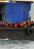 Crewman washing, Halong Bay