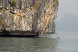 The seawater has eroded the limestone formations in Halong Bay