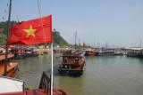 Vietnamese flag and the Bai Chay tourist port, Halong City