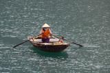 Old woman rowing a boat, Halong Bay