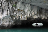 The cave opens up to the hollow center of a limestone island filled with a lagoon