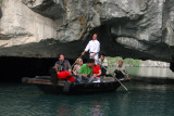 Rowboat passing through Hang Luon Cave into the lagoon