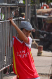 Vietnamese boy with a Fly Emirates shirt, Halong City