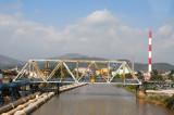Bridge across a river in an industrial town near Halong City