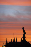 Sunset with the statue atop Església de la Mercè