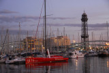 Port Vell, Barcelona waterfront at dusk with Torre Jaume I (1931)