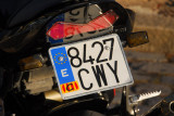 Motorbike with a Spanish license plate and Catalonia sticker