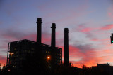 Industrial chimneys of the Endesa power plant at the base of Montjuïc with a beautiful red sky