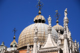 Dome of the Basilica di San Marco behind sculptures on the small spires of the Foscari Arch