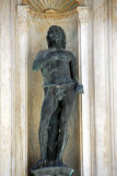Bronze statue of Adam by Antonio Rizzo in a niche on east side of the the Foscari Arch