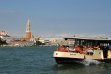A Venetian Actv vaporetto with the Campanile of St. Mark