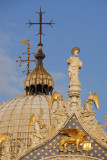 Cross on top of the main dome with the statue of St. Mark