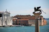 The column of St. Mark with the white façade of San Giorgio Maggiore across the Bacino di San Marco