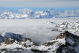 Italian Alps rise above the cloud covered Valle d'Aosta